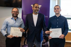 Vikram Jandhyala presents the Endowed Innovation Award in Electrical Engineering to Max Pfeiffer (Undergraduate Award) and Sep Makhsous (Graduate Award).