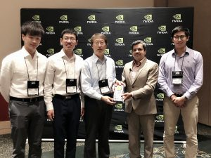 Hwang and his team, Zheng Tang, Gaoang Wang and Hao Xiao, and undergraduate student Aotian Zheng, receiving their award.