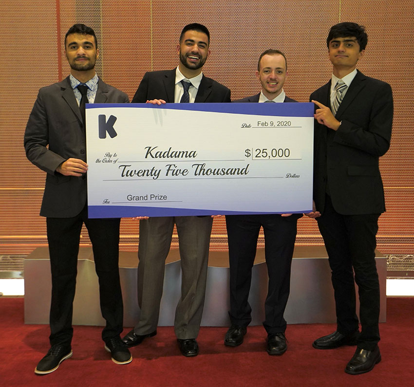 Kadama team members holding large $25,000 check