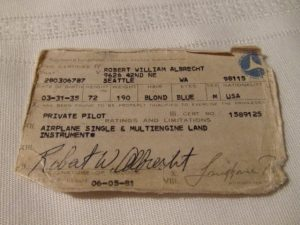 An old, crumpled pilot's license