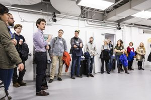 Sam Burden talking to a group of people in the AMP Lab