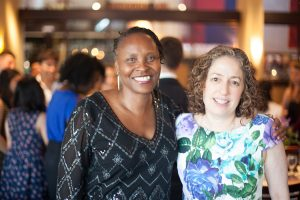 Sonya Cunningham and Eve Riskin at a social gathering